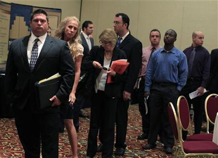 People wait in line to meet with recruiters during a job fair in Melville, New York July 19, 2012. REUTERS/Shannon Stapleton