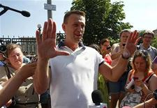 Prominent anti-corruption blogger and opposition leader Alexei Navalny gestures after leaving the Investigative Committee of the Russian Federation in Moscow July 31, 2012. Russian authorities charged Navalny on Tuesday with a financial crime punishable by prison, increasing pressure on one of President Vladimir Putin's leading foes. REUTERS/Mikhail Voskresensky