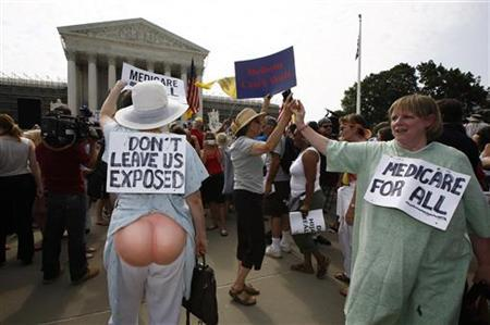 Supporters of U.S. President Barack Obama's 2010 healthcare overhaul react outside the Supreme Court in Washington June 28, 2012. REUTERS/Jason Reed