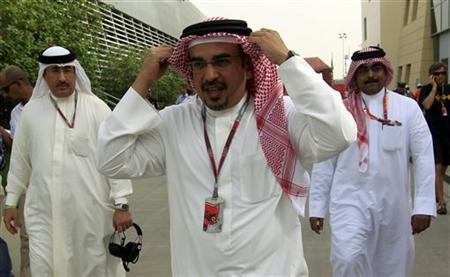 Crown Prince Sheikh Salman bin Hamad al-Khalifa (C) and a government delegation walk in the paddock after the second practice session of the Bahrain F1 Grand Prix at the Sakhir circuit in Manama April 20, 2012. REUTERS/Ahmed Jadallah