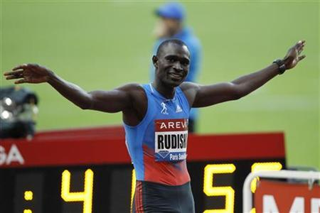David Rudisha of Kenya celebrates after winning the men's 800 metres at the IAAF Diamond League athletics meeting at the Stade de France Stadium in Saint-Denis, near Paris July 6, 2012. REUTERS/Gonzalo Fuentes