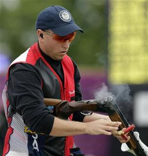 Vincent Hancock of the U.S. discharges the rounds from his rifle during the men's skeet finals at the Royal Artillery Barracks during the London 2012 Olympic Games July 31, 2012. REUTERS/Cathal McNaughton