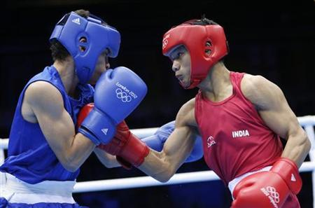 Devendro Singh Laishram (R) fights against Honduras' Bayron Molina Figueroa in the Men's Light Fly (49kg) Round of 32 boxing match during the London 2012 Olympic Games July 31, 2012. REUTERS/Murad Sezer