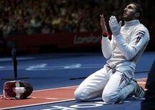 Egypt's Alaaeldin Abouelkassem celebrates defeating Italy's Andrea Cassara during their men's individual foil quarterfinal fencing competition at the ExCel venue at the London 2012 Olympic Games July 31, 2012. REUTERS/Max Rossi
