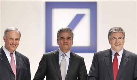 Anshu Jain (C) and Juergen Fitschen (L) designated co-successors of Josef Ackermann (R), outgoing CEO of Germany's largest business bank, Deutsche Bank AG pose for a picture prior to the bank's annual shareholders meeting in Frankfurt May 31, 2012. REUTERS/Alex Domanski