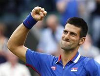 Serbia's Novak Djokovic celebrates after winning his men's singles tennis match against Andy Roddick of the U.S. at the All England Lawn Tennis Club during the London 2012 Olympic Games July 31, 2012. REUTERS/Stefan Wermuth