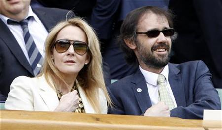 Author J.K. Rowling and her husband Neil Murray sit on Centre Court at the Wimbledon tennis championships in London June 26, 2012. REUTERS/Stefan Wermuth