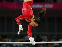 Jordyn Wieber of the U.S. performs on the asymmetric bars during the women's gymnastics team final in the North Greenwich Arena at the London 2012 Olympic Games July 31, 2012. REUTERS/Mike Blake