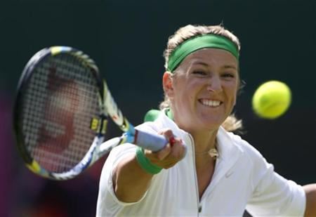 Belarus' Victoria Azarenka returns to Romania's Irina-Camelia Begu in their women's singles tennis match at the All England Lawn Tennis Club during the London 2012 Olympics Games July 30, 2012. REUTERS/Stefan Wermuth