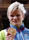Gold medallist Slovenia's Urska Zolnir celebrates her victory after the awards ceremony for the women's -63kg judo competition at the London 2012 Olympic Games July 31, 2012. REUTERS/Kim Kyung-Hoon