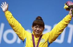 Kazakhstan's Maiya Maneza celebrates at the podium her victory on the women's 63Kg weightlifting competition at the ExCel venue at the London 2012 Olympic Games July 31, 2012. REUTERS/Grigory Dukor