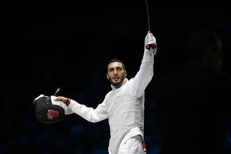 Egypt's Alaaeldin Abouelkassem celebrates defeating South Korea's Choi Byungchul during their men's individual foil semifinal fencing match at the ExCel venue at the London 2012 Olympic Games July 31, 2012. REUTERS/Damir Sagolj