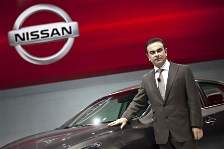 Carlos Ghosn, president and CEO of Nissan, poses with the new Nissan Altima at the 2012 New York International Auto Show in New York in this file photo taken April 4, 2012. REUTERS/Andrew Burton