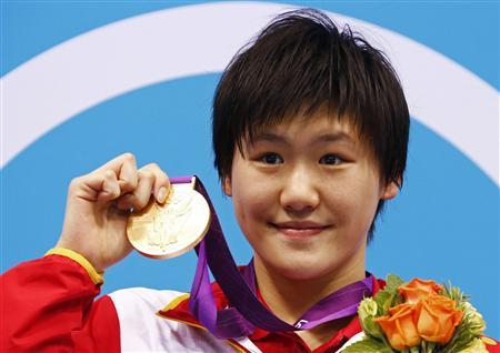 China's Ye Shiwen poses with her gold medal on the podium during the women's 400m individual medley victory ceremony at the London 2012 Olympic Games at the Aquatics Centre in this July 28, 2012 file photograph. REUTERS/David Gray
