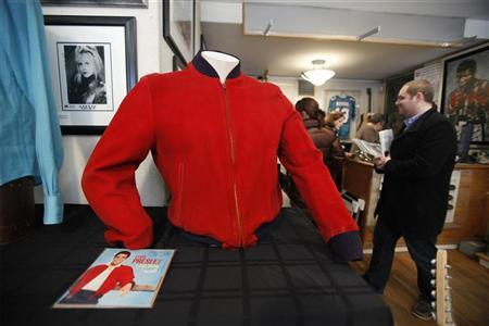 A red suede jacket worn by Elvis Presley on the ''Jailhouse Rock'' 45 cover is displayed during a media preview by the Gotta Have It! auction house before an online auction of memorabilia in New York March 1, 2010. REUTERS/Lucas Jackson (