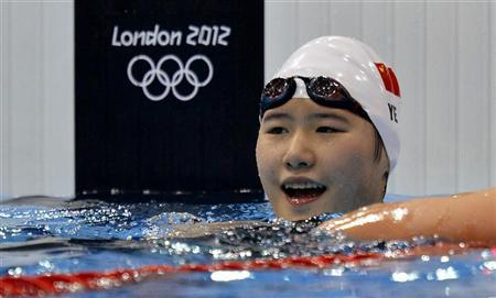 China's Ye Shiwen smiles after winning the women's 200m individual medley final during the London 2012 Olympic Games at the Aquatics Centre July 31, 2012. REUTERS/Toby Melville
