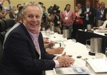 Quebec Premier Jean Charest (L) smiles during a photo op before a meeting between Canada's premiers in Halifax, Nova Scotia, July 26, 2012. REUTERS/ADAM SCOTTI