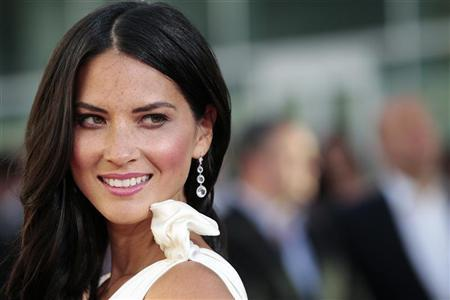 Cast member Olivia Munn poses at the premiere of the HBO television series ''The Newsroom'' at the Cinerama Dome in Los Angeles, California June 20, 2012. REUTERS/Mario Anzuoni
