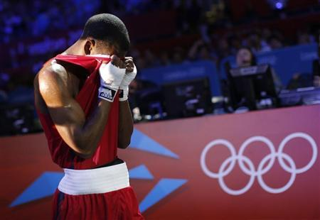 Jamel Herring of the U.S. reacts as he leaves the ring after losing to Kazakhstan's Daniyar Yeleussinov in the Men's Light Welter (64kg) Round of 32 boxing match during the London 2012 Olympic Games July 31, 2012. REUTERS/Murad Sezer