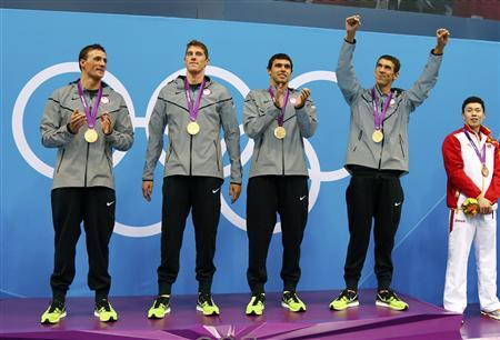 Members of the men's 4x200m freestyle relay team, Ryan Lochte, Conor Dwyer, Ricky Berens and Michael Phelps (L-R), celebrate their gold medal win in the men's 4x200m freestyle relay victory ceremony during the London 2012 Olympic Games at the Aquatics Centre July 31, 2012. REUTERS/David Gray