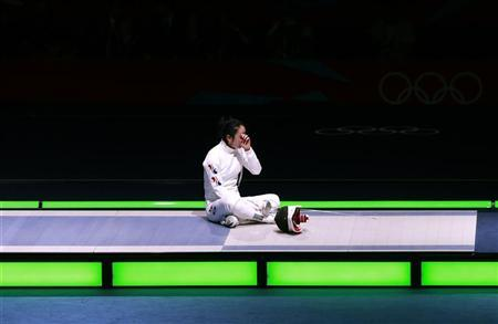 South Korea's Shin A Lam reacts after being defeated by Germany's Britta Heidemann (not seen) during their women's epee individual semifinal fencing competition at the ExCel venue at the London 2012 Olympic Games July 30, 2012. REUTERS/Adrees Latif