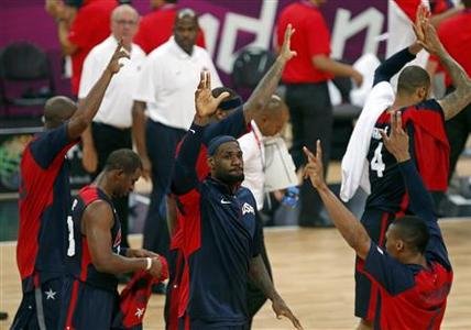 Lebron James of the U.S. waves to the crowd after their men's preliminary round Group A basketball match against Tunisia at the Basketball Arena during the London 2012 Olympic Games July 31, 2012. REUTERS/Mark Blinch