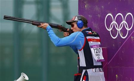 Czech Republic's Jakub Tomecek takes aim during the skeet men's qualification round at the Royal Artillery Barracks during the London 2012 Olympic Games July 30, 2012. REUTERS/Cathal McNaughton