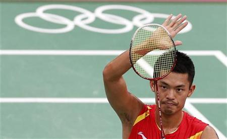 China's Lin Dan celebrates after winning against Indonesia's Taufik Hidayat during their men's singles round of 16 badminton match during the London 2012 Olympic Games at the Wembley Arena August 1, 2012. REUTERS/Bazuki Muhammad