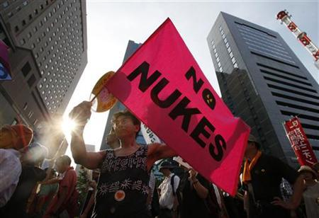 An anti-nuclear protester holds a flag reading: ''No Nukes'' during a demonstration in Tokyo July 29, 2012. REUTERS/Yuriko Nakao