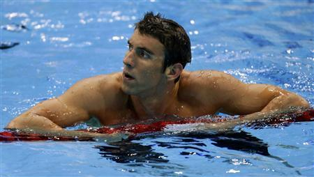 Michael Phelps of the U.S. looks up after his men's 200m individual medley heat during the London 2012 Olympic Games at the Aquatics Centre August 1, 2012. REUTERS/Tim Wimborne