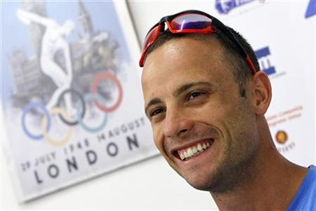 Oscar Pistorius of South Africa smiles as he speaks during a news conference after the men's 400 meters event at the 23rd International athletics meeting in Lignano Sabbiadoro July 17, 2012. REUTERS/Alessandro Garofalo