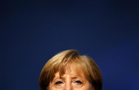 German Chancellor and leader of Germany's conservative Christian Democratic Union (CDU), Angela Merkel listens to the speech of party general secretary Hermann Groehe during the party convention at the fairground in Leipzig, November 14, 2011. REUTERS/Kai Pfaffenbach