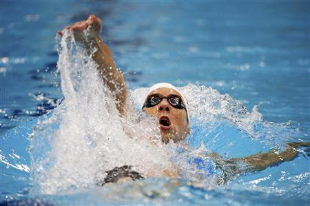 Michael Phelps of the U.S. swims in his men's 200m individual medley heat during the London 2012 Olympic Games at the Aquatics Centre August 1, 2012. REUTERS/David Gray