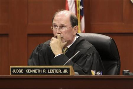 Circuit Court Judge Kenneth R. Lester Jr. presides over a hearing scheduled to deal with several media organization's request to unseal documents from George Zimmerman's court file and discuss donations raised by a web site for his legal defense at the Seminole County Criminal Justice Center in Sanford, Florida, April 27, 2012. REUTERS/Red Huber/Pool
