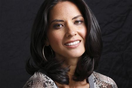 Actress Olivia Munn poses for a portrait while promoting the film ''The Babymakers'' in Los Angeles, July 24, 2012. Photo taken July 24, 2012. REUTERS/Danny Moloshok