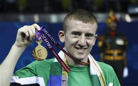 Northern Ireland's Paddy Barnes holds his gold medal in the men's Light Fly weight 46-49kg final boxing match during the medal ceremony at the Commonwealth Games in New Delhi October 13, 2010. REUTERS/Adnan Abidi