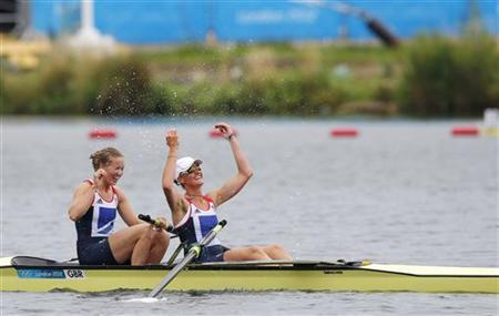 Britain's Helen Glover and Heather Stanning celebrate winning the gold medal after their women's pair Final A at Eton Dorney during the London 2012 Olympic Games August 1, 2012. REUTERS/Darren Whiteside