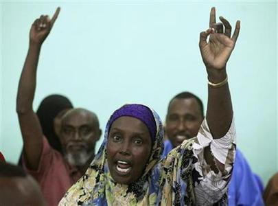 Delegates to the Somali National Constituent Assembly raise their hands during the conference in capital Mogadishu August 1, 2012. REUTERS/Ismail Taxta