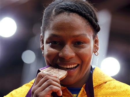 Bronze medallist Colombia's Yuri Alvear celebrates with her medal after the awards ceremony for the women's -70kg judo competition at the London 2012 Olympic Games August 1, 2012. REUTERS/Kim Kyung-Hoon
