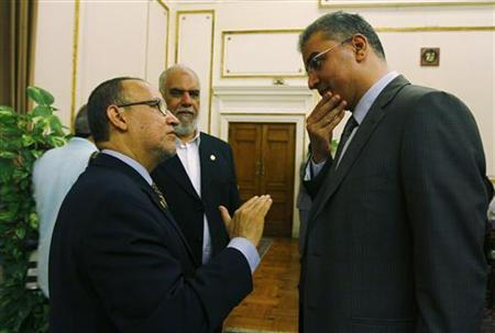 Parliament members Essam Sultan (R) and Essam el-Erian (L) talk after a session at the parliament building in Cairo, July 10, 2012. REUTERS/Stringer