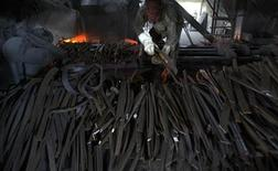 A labourer works inside a steel factory in the eastern Indian city of Siliguri July 16, 2009. REUTERS/Rupak De Chowdhuri