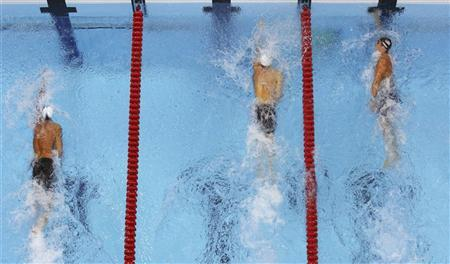 Nathan Adrian (R) of the U.S. finishes first in his men's 100m freestyle semi-finals during the London 2012 Olympic Games at the Aquatics Centre July 31, 2012. REUTERS/Andrew Winning