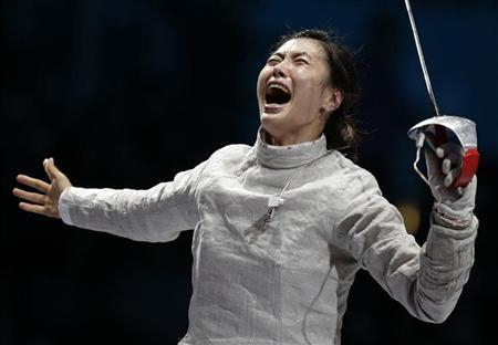 South Korea's Jiyeon Kim celebrates winning against Russia's Sofya Velikaya at the end of their women's sabre individual gold medal fencing match at the ExCel venue during the London 2012 Olympic Games August 1, 2012. REUTERS/Max Rossi