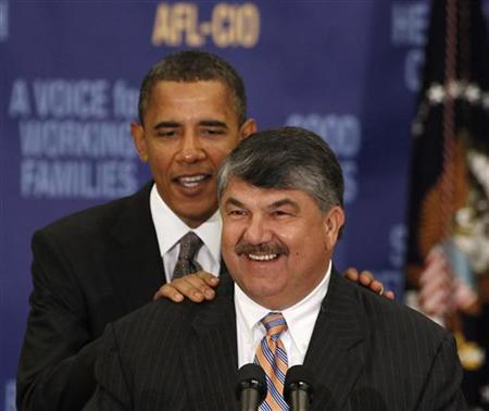 President Barack Obama (L) stands behind AFL-CIO President Richard Trumka before he speaks at the AFL-CIO Executive Council meeting at the Washington Convention Center in Washington, August 4, 2010. REUTERS/Larry Downing