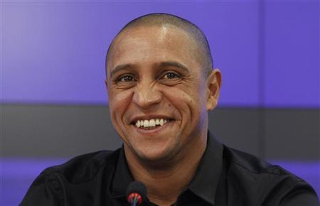 Anzhi Makhachkala team director Roberto Carlos laughs during a news conference in Moscow March 29, 2012. REUTERS/Sergei Karpukhin