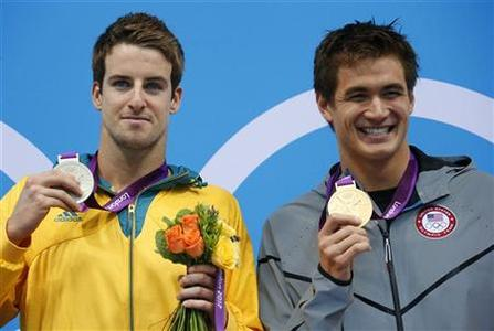 Gold medallist Nathan Adrian of the U.S. (R) and silver medallist James Magnussen of Australia pose with their medals during the men's 100m freestyle victory ceremony at the London 2012 Olympic Games at the Aquatics Centre August 1, 2012. REUTERS/David Gray