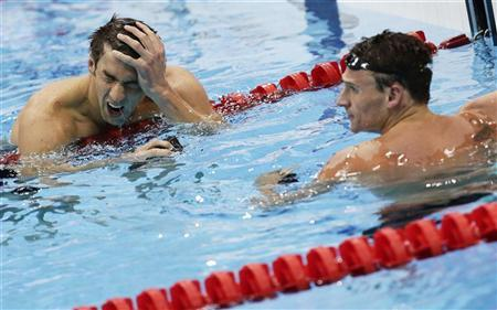 Michael Phelps (L) and Ryan Lochte of the U.S. react after their men's 200m individual medley semi-final during the London 2012 Olympic Games at the Aquatics Centre August 1, 2012. REUTERS/Tim Wimborne