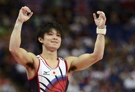 Kohei Uchimura of Japan gestures after competing in the vault during the men's individual all-around gymnastics final in the North Greenwich Arena during the London 2012 Olympic Games August 1, 2012. REUTERS/Dylan Martinez
