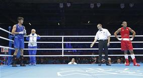 Iran's Ali Mazaheri (L) refuses to take part in the decision after being disqualified during his Men's Heavy (91kg) Round of 16 boxing match against Jose Larduet Gomez of Cuba at the London 2012 Olympic Games August 1, 2012. REUTERS/Murad Sezer