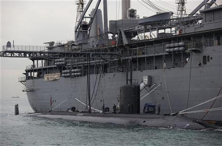 A Los Angeles-class, fast attack submarine USS Hampton moors alongside the submarine tender USS Frank Cable in Hong Kong waters May 17, 2011. REUTERS/Vincent Yu/Pool